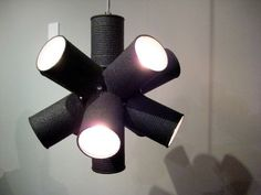 pendant light made of black painted metal cans