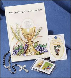 """Treasured Memories First Communion Set - Boy  Item Number: KS182  Sale Price $29.95 Order Here  Description:  Set includes a 96-page First Communion Mass book, an Italian-made 5 mm, 17"""" L blackImit. Pearl First Communion rosary, a brown scapular, a full-color enamel First Communion pin and a matching gift box (not shown). Gift Boxed. -- 5 1/2"""" W x 7 1/2"""" H http://www.marianland.com/automchurchsupply/Shepherd_Figure_18007.html"""