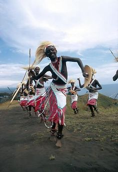 Africa | Ntore dancers performing traditional Tutsi dance, on shore of Lake Kivu. Goma, Congo (Democratic Republic) | Originally, the Ntore dancers were the pages of the Mwami court; they were all sons of chiefs or notables. The choreography consisted principally of warlike dances called the Ikumu (the lance), the Umuheto (the bow) and the Ingabo (the shield), in which the dancers carried real arms. | ©Eliot Elisofon. 1972