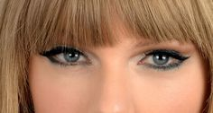 Is This Taylor Swift's Coolest Eye Makeup Look Yet? (She's got a blue-green eyeliner around her lids and dragged out into a cat-eye at the corners. There's a shimmery silver eyeshadow on her upper lids up the creases and in her inner corners. Then in the creases: A line of matte taupe eyeshadow.)
