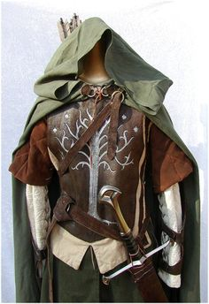 Faramir. green cloak + brown tunice + white undershirt + paper mache breastplate + grean/brown pants + sword + belt