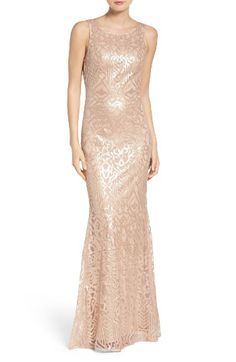 Free shipping and returns on WTOO Sequin Embroidered Cowl Back A-Line Gown at Nordstrom.com. Whether coming or going, this gown presents an elegant and glamorous look embroidered with an ornate pattern of glimmering sequins in a fluid A-line cut. The high bateau neckline in front is balanced by a gracefully draped cowl at the back.