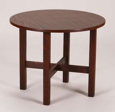 Gustav Stickley round child's table.  Perfect for a low side table of coffee table.  Unsigned.  Very nicely refinished.