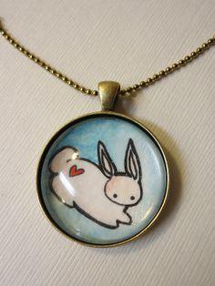 Bunny with a heart tat on his bunny bottom. CUTE.
