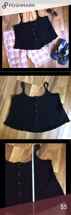 "Black Forever 21 Crop Top Women's Medium Such a cute top! I'm just not sure how to wear it in a way that says me. So while I'm deliberating I listed it on here! Forever 21 flowy crop top. Women's size medium. Metal buttons running down the front. Straps adjust so it can be a little longer or shorter than the length measurement below. Very light wear overall. Measurements: Bust 16"" lying flat, 16"" long If you have questions about the item (Or ideas on how you wear a crop top!), just ask…"