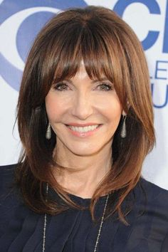The Best Hairstyles for Women Over 60 / Center-Parted Bangs