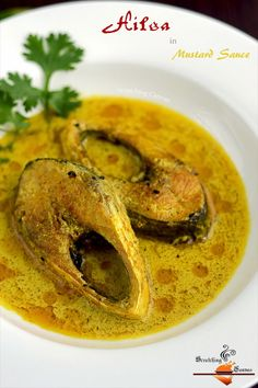 Hilsa in simple Mustard Sauce or Ilish Shorshe is the simplest recipe of Hilsa and mustard paste. This duo can create half a dozen different awesome recipes also. This recipe needs 15 mins and handful of ingredients only. Fried Fish Recipes, Veg Recipes, Spicy Recipes, Curry Recipes, Seafood Recipes, Indian Food Recipes, Vegetarian Recipes, Cooking Recipes, Recipies