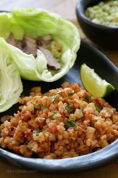 """This Mexican inspired dish of Cauliflower """"Rice"""" uses finely chopped cauliflower, which makes a fantastic low-carb, grain-free stand in for rice. You can season it many different ways, here I sauteed sauteed it with tomatoes, onions, jalapeno and spices."""