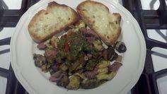 Saturday night grilling leftovers!  Roasted pepper cilantro pecan pesto over grilled steak and mushroom scramble.