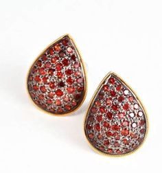 Garnet pave ear studs - Cabochon garnets studded in a union of gold and silver metals.
