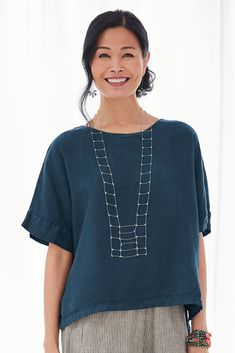 Roma Top by Lisa Bayne . A top that looks great on nearly everyone and layers beautifully with almost everything. With a high-low hem and extended shoulders, it offers cool coverage in breezy linen.