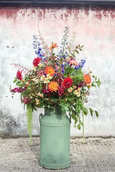 example of a large milk churn arrangement (in different colours)