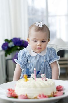 Princess Estelle of Sweden | The Royal Hats Blog--The Swedish Royal Court released several photos for Princess Estelle's first birthday today. As she is wearing a sweet hair bow.