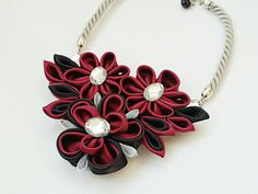 Check out this item in my Etsy shop https://www.etsy.com/listing/276360268/maroon-black-kanzashi-tsumami-flowers