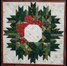The Christmas Wreath quilt was a design that was published in Quiltmaker magazine from 2000. The instructions for making this wall quilt were given over 3 months and it was labeled 'Mystery Christmas Quilt'. One of our quilting group members organised the day for us to make this quilt and all we knew was that we would be making a mystery Christmas quilt. The pattern was organised in such a way that none of us knew what we were making until the end.