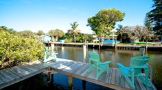 Anna Maria Island vacation rental HoneyWood House has it all with a canal boat dock and a heated pool!