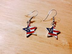 Check out this item in my Etsy shop https://www.etsy.com/listing/529777493/star-shaped-us-flag-earrings-with