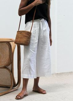 White linen is your best friend on those warm vacations. Pair with a black tank and slide on leather shoes. Let Daily Dress Me help you find the perfect outfit for whatever the weather!