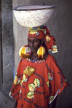 Africa   This woman from Sevare in Mali, was showing her weddings jewels to her friend when I saw her. As it is traditional amongst the Fulani women, the tattoo around her mouth indicates that she is married and is designed to make her less attractive to other men.    © Image and caption Maxime Alvarez de Toledo