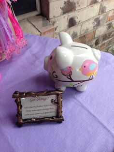 Baby shower game, if guest have change they are welcomed to put into the babys first piggy bank (not required) - everyone gets to guess how much is collected at the end. Closest guess gets a prize.:  Mike and Nicole want to pick out a cute robot piggy bank.