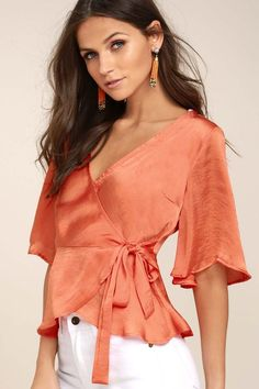 Lulus Exclusive! We swear the Heart to Heart Coral Orange Satin Wrap Top will be your new fave! This sleek satin wrap top has a darted bodice, plunging neckline, and fluttering short sleeves. Waist tie allows a custom fit above a ruffled hem.