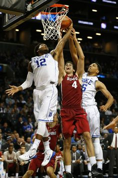 Jahlil Okafor had 10 points and 12 rebounds and dominated the closing minutes in leading No. 4 Duke to a 70-59 victory over Stanford in the championship game of the Coaches vs. Fellow freshman Justise Winslow added 14 points and nine rebounds, and Quinn Cook had 18 points as Mike Krzyzewski got the best of former assistant Johnny Dawkins in the first coaching matchup between the longtime Blue Devils coach and his former player.