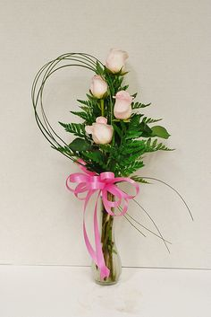 Lisa's four bloom standard rose bud vase with bear grass embellishment