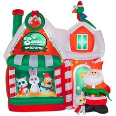 airblown inflatable santas pet shop scene