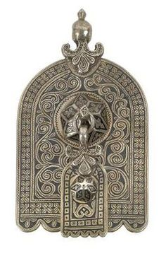 Silver Moroccan house symbol in  Hand of Fatima (Hamza) form.  A house symbol that is hung in the house as a protective amulet.  A small Hand of Fatima with a similar pattern hangs on a central knob.