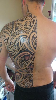 Back Tattoo Polynesian Style under the Middle of the Back of a Man by Henua Tiki Tattoo