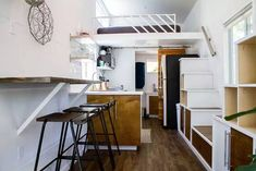 River Resort is a modern double-loft tiny house with two staircases : TreeHugger
