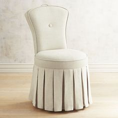 Our movie-star gorgeous Reese Vanity Chair is not just picture perfect—it has an ingenious side, too. The gorgeous part: Plush padded linen on a sturdy hardwood frame with self-welt detail, button tufting and an elegant box-pleated skirt. The genius part: A little handle on top to move the chair without getting it dirty.