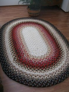 This gorgeous 100 wool handmade ovalshaped braided rug by TrizzyGs, $400.00