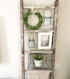 Cute way to display things by using old ladder like this with baskets.
