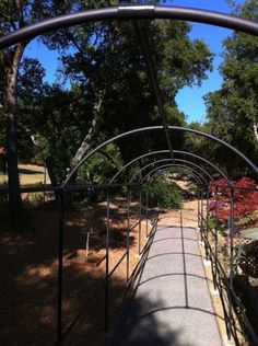 We were inspired during a trip to France with creating a garden arched walkway.  Commonly called Monet's Arch, these structures aren't available commercially in anything but small sections, but we wanted a 50ft walkway.  So we created one with pipe, Kee Klamp fittings and some powder coating.