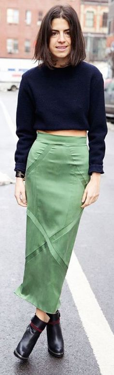 Leandra Medine of Man Repeller wearing a green midi skirt with navy blue cropped sweater and ankle boots