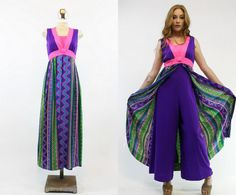 Awesome 1970s jumpsuit! Made in a multi-colored geometric print. Super soft brushed cotton blend material. Bodice is colorblocked in a deep royal purple and hot pink. Deep V neckline with a snap-removable modesty panel. Empire waistline. Center back zipper. Super wide deep purple flare pants. Attached long skirt with a front slit to expose the awesome pants! Unlined.  ♥♥♥ Brand: Krist Size on tag: Nonw Fits like: Medium Color: Purple, Pink, Green Material: Cotton blend Condition: Excellent…
