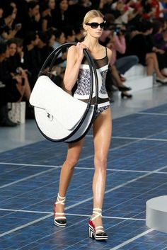 I think I want one of these as my new summer bag!! Hula bag at the Chanel SS2013 show in Paris