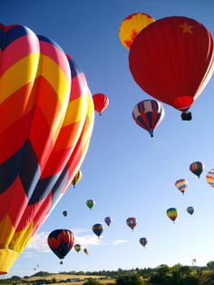 Ride in a Hot Air Ballon during sunrise or sunset over the mountains in the fall when the leaves are at their peak color. How beautiful would that be!
