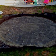 Gray paver fire pit patio.