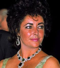 Elizabeth Taylor  wearing emeralds made into a suite for her by her husband, Richard Burton which included earrings, necklace, pendant/brooche, bracelet and ring.  A number of the emeralds in this suite, it has been said, came from the jewelery collection of Grand Duchess Maria Pavlovna 'the Elder' (aka Grand Duchess Vladimir) of Russia.