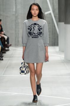 Runway elegance with the grey sportswear dress, handbag and blue shoes from the #LacosteFW15 fashion show. © Yannis Vlamos