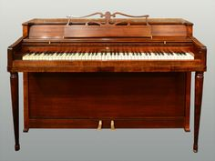 American upright piano in mahogany by Wurlitzer, circa 1950. Serial #629633.