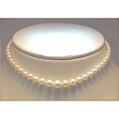 "14"" strand of graduated pearls with fantastic luster and highest quality.  14K white gold clasp and 5 to 8.25mm pearls."