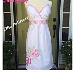 """Lilly Pulitzer Dress  White Camellia Cross Stitch Beautiful Lilly dress with cross stitched flowers and leaves around the chest and on the front. Made of 98 % cotton and 2% spandex. The bust measures 34"""" and underneath bust is 28"""", length is 29"""" from underarm and straps are adjustable. Wash in cold and hang to dry or dry clean. This is a gorgeous dress. Lilly Pulitzer Dresses"""