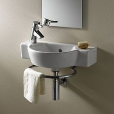 Vitra Sunrise Cloakroom Basin with Towel Rail One Left Hand Tap Hole. Vitra Bathroom Collection is a complete range of bathroom products. Excellent quality combined with real value, provides a recipe for success for the retailer and the consumer alike. http://www.dealsonbathrooms.co.uk/vitra-sunrise-cloakroom-basin-with-towel-rail-one-left-hand-tap-hole.html#.VA64YvmwJKU