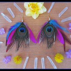 Fun colorful peacock feathers going to a new home today.  Beautiful for festival wear or just fun everyday wear!  find them in my etsy shop WWW. DIESELBOUTIQUE. ETSY .COM   #electricforest #earrings #highsociety #featherearrings #feathers  #Burningman #festival #hippie #festivalfashion #boho #bohemian #gypsy #festivals #carnaval #peacock #etsy #moda #goodvibesonly #bohochic #bohostyle #coachella #tribal #ibiza #plur #gypsysoul #edc #edm #daffodils #gypsylife #etsyshop