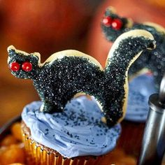 These Halloween-themed party treats--including fudgy cat cupcakes and pumpkin bars--will please both the young trick-or-treaters in your house as well as grown-ups.