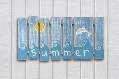 Dolphin Chalky Finish Wall Decor -- Paint a summer scene on a wooden pallet.