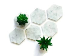 These coasters are made from beautiful polished Carrara marble. There are cork pads on the bottoms to prevent sliding and scratching. Marble is porous, so be sure to clean up spills immediately. Clean using water or mild detergents.  Available in set of 2, 4, or 6. Each one measures 4 from point to point.  Let me know if you have any questions! :)